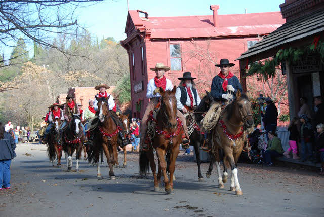 Group of cowboys riding in a parade