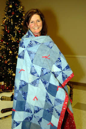 Sue Flagg and her new quilt.
